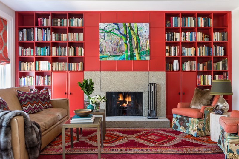 Beautiful interior design in living room with red built-ins and patterned chairs