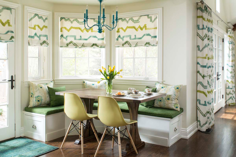 Beautiful interior design in informal dining area with bench seating and green chairs