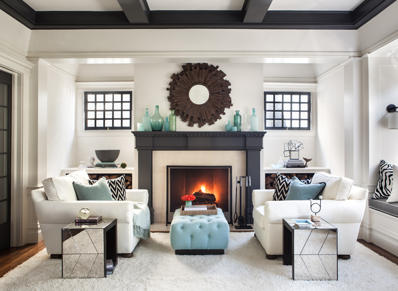 Beautiful interior design in living room with symmetrical white couches and light blue accents