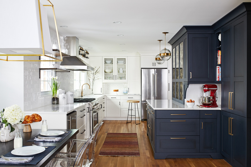 Beautiful interior design in kitchen with navy cabinets and gold finishings
