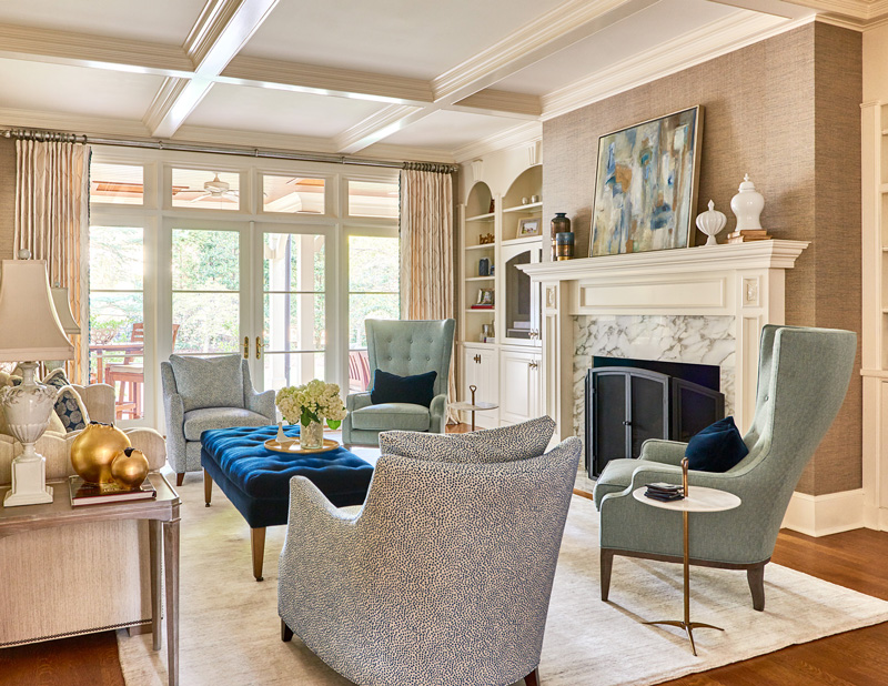 Beautiful interior design in living room with blue armchairs and neutral accents